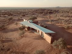slee & co. architects' red earth game lodge emerges from the namibian landscape Vernacular Architecture, Architecture Design, Tropical Architecture, Residential Architecture, Earth Games, Farm Gate, Corrugated Roofing, Game Lodge, Earth Color