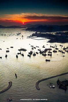 Hong Kong, puesta del sol de Kowloon del oeste