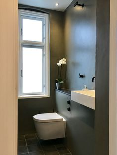 Small powder/shower room in Copenhagen. Walls in KABE stone, colour 'rock', bathroom hardware by VOLA in matt black Guest Toilet, Wall Finishes, Bathroom Hardware, Wall Colors, Copenhagen, Small Bathroom, Nouvel An, Shower, Interior Design