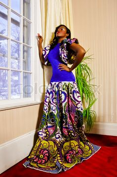 Google Image Result for http://www.colourbox.com/preview/5097435-271187-african-print-gown-by-designer-b-chris-couture.jpg