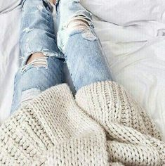 A cozy knit sweater paired with boyfriend jeans.