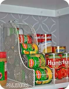 Love this idea! Magazine racks to hold canned goods. Bobby Pins are spray painted white used as a guard to prevent cans from falling down.
