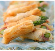 Make these ahead - they will freeze for 2 months!  So yummy.  Phyllo around proscuitto and aparagus - bake for 5 minutes....so pretty and so good