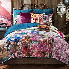 Inspired by vibrant hand-dyed textiles, the Leandre quilt bursts with an exciting variety of colors and patterns that will fill your bedroom with a free-spirited bohemian flair. Quilt reverses to a solid teal for an easy way to change up your bed's look.
