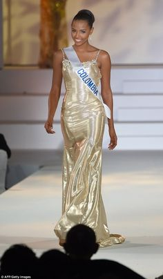 First runner-up: MsSuárez, a 20-year-old from Colombia, dazzles in a gold gown...