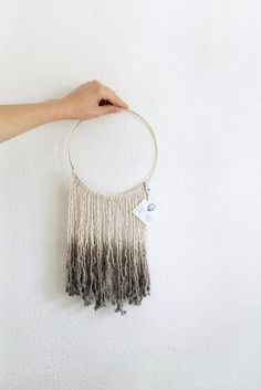 Ombre dyed cotton wall hanging with brass loop.