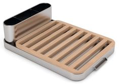 Dish rack from Universal Expert by Sebastian Conran. Rubber feet provide angle draining - with a removable cutlery drainer.