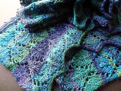 This scarf is worked lengthwise to pull out the stripes in the yarn.   The pattern can also be worked horizontally with fewer stitches.   Th...