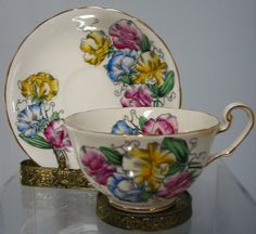 BEAUTIFUL,VICTORIA  HAND PAINTED VINTAGE CUP AND SAUCER ,SWEET PEA ,ENGLAND,RARE #VICTORIA