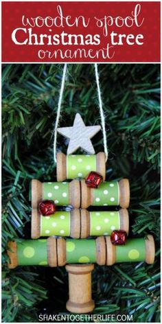 Paper wrapped wooden spools make a charming Christmas tree ornament - add jingle bell ornaments and a gold star, too! by lakeisha