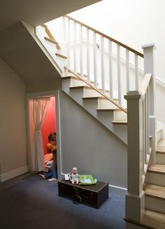 Build a kids play area under the stairs! When they grow too big, convert to storage.
