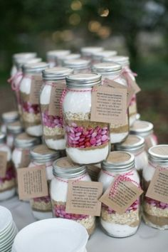 cookie in a mason jar favors - use colored m&m's to tie in your wedding colors - add a recipe card / thank you card tied on with baker's twine