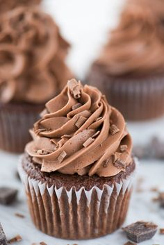 Our family loves this recipe for easy chocolate cupcakes! These box mix chocolate cupcakes are super moist and chocolatey because of the added buttermilk and cocoa powder, plus our recipe doesn't call for pudding mix or coffee! Learn our cake mix hacks for how to make box mix cupcakes taste homemade! #chocolatecupcakes #cupcakes #easycupcakes Chocolate Cupcake Recipe Without Buttermilk, Best Chocolate Cupcakes, Chocolate Frosting Recipes, Chocolate Buttercream Frosting, Chocolate Cake Mixes, Melting Chocolate, Buttercream Ideas, Icing Recipes, Chocolate Icing