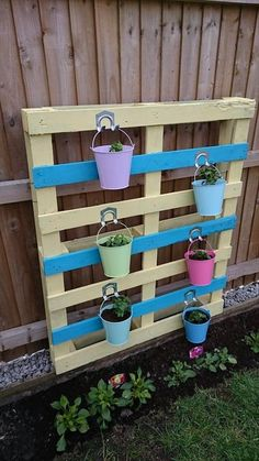 Reclaimed Pallet #Herb #Planter | 101 Pallet Ideas - Make you green place aesthetically pleasing to eyes! Just make your pallets painted and make them capable of holding the buckets to do the magic!