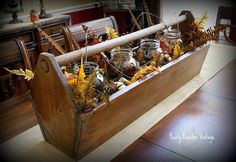 Fall in a tool box...great idea, now I need to go to the antique shops and find one.