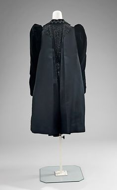 Coat, Evening.  House of Worth (French, 1858–1956).  Designer: Attributed to Charles Frederick Worth (French (born England), Bourne 1825–1895 Paris). Designer: Attributed to Jean-Philippe Worth (French, 1856–1926). Date: 1890–98. Culture: French. Medium: silk, jet. Dimensions: Length at CB: 40 in. (101.6 cm).