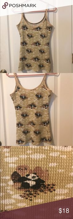Free People Panda Tank Cute top! Great for lounging or running errands! Size small but could probably fit a medium as well. Cotton waffle knit. Some fraying along hem, but this is due to the finishing of the hem and fabric style. Overall good condition. From a non smoking home. Free People Tops Tank Tops