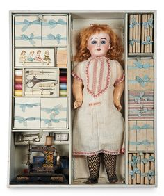 French bisque Bebe Mignon in sewing presentation box