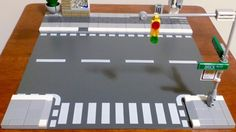 Pavement & Street Furniture The curb is raised and is wheelchair-accessable from the crosswalk (in order to accommodate the new wheelchair minifig coming out in May Lego Road, Modele Lego, Lego Pictures, Lego Christmas, Lego Trains, Lego Architecture, Architecture Diagrams, Architecture Portfolio, Lego Modular