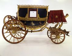 Carriages in Regency England : Berlin- has four wheels and a hood. This vehicle was known to be fast and light. It has two interior seats and a separate hooded rear seat for a footman, which was detached from the body. The Berlin's light weight made it less likely to tip than other carriages. A stirrup or footstool made the vehicle easier to board. Instead of side windows, there were hoods to let down in case of inclement weather. via : lahilden