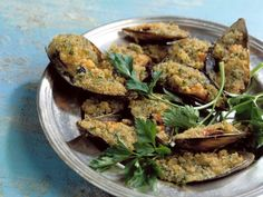Überbackene Muscheln (Cozze gratinate) ist ein Rezept mit frischen Zutaten aus der Kategorie Kochen. Probieren Sie dieses und weitere Rezepte von EAT SMARTER!
