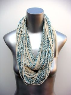 Love this scarf- and to make one out of t-shirts cut up (a certain way- there are tutorials all over youtbube)- is so easy! Take inspiration from the striped pattern and neutral color accents used here!