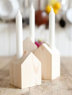 chimney candles in little wooden houses
