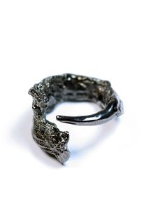 This ring was originally formed from tangled fibres and a forged nail, a combination of organic yarns with the fiercest spike.