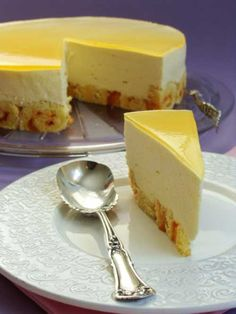 Recipe for Mango Mousse Cake - If you are not going to be going on a tropical vacation, this cake is the next best thing! If you are going on a tropical vacation, keep it going with this cake.