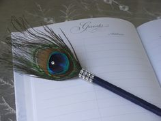 Peacock Feather Pen Favor with BLING in your choice of by Ivyndell, $10.00 lilly wants