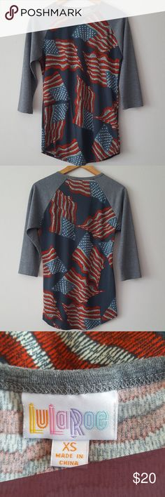 "NWOT LULAROE USA/AMERICAN FLAG/PATRIOTIC RANDY TOP NWOT Lularoe USA flag ""Randy"" baseball style top - Size XS Gray raglan sleeves with blue body and all-over USA flag print  Super soft! - 96% polyester, 4% spandex  Approx. 20 inch raglan sleeves, Approx. 17.5 inch bust measured flat, Approx. 28 inches in length LuLaRoe Tops Tees - Long Sleeve"