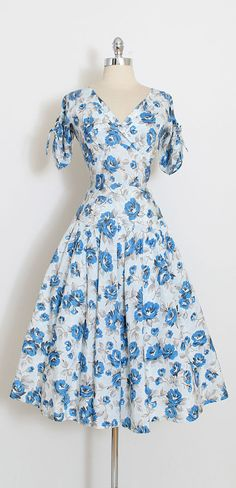 ➳ vintage 1950s dress * beautiful blue rose print acetate * slight dropped waist * extra full skirt * skirt lined in light layer or muslin * metal back zipper * drawstring tie sleeves condition | excellent fits like medium length 48 bodice 17 bust 38-40 waist 27-28 ➳ shop http://www.etsy.com/shop/millstreetvintage?ref=si_shop ➳ shop policies http://www.etsy.com/shop/millstreetvintage/policy twitter | MillStVintage facebook | millstreetvin...