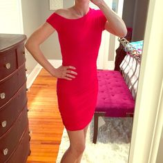 Bebe red ruched dress This dress is hot! A little off the shoulder, super stretchy ruched material is very flattering on curves, pretty shoulder detail and beautiful poppy color. Worn once to a wedding. 93% rayon; 7% spandex. Smoke and pet free home. bebe Dresses Midi