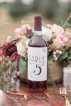 Wine bottle table number for rustic Christmas wedding