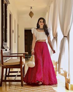 croptop lehenga designs Bride in plain white ruffle sleeves blouse paired with a polkadot skirt with statement jewelry Indian Fashion Dresses, Indian Gowns Dresses, Dress Indian Style, Indian Designer Outfits, Indian Outfits, Indian Dresses For Girls, Indian Bridal Fashion, Girls Dresses, Long Dress Design