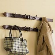 A pair of old skis with hooks added to make a coat rack