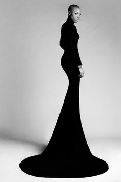 Black & white fashion photography - model posing in an elegant gown with a dramatic silhouette