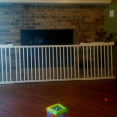 Use your old crib rails as an extra wide baby gate! Just add hinges!