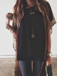 Relaxed boho-rocker style- blue wash skinnies, loose fit black T and sheer leopard kimono. Layer bracelets, necklaces & rings-keeping with the boho vibe...