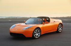 Amazing Tesla Roadster in Orange High Definition Wallpapers