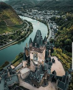 This imposing castle towers above the little town of Cochem in the Rhineland-Palatinate region. Did you know Cochem is one of the best… Cities In Germany, Germany Travel, Black Forest Mountains, Places To Travel, Travel Destinations, Holidays Germany, Rhineland Palatinate, Beautiful Castles, Beautiful Beautiful