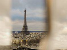 The Eiffel Tour seen through the wheels of the Grande Roue de Paris (ferris wheel) by just_jeanette, via Flickr