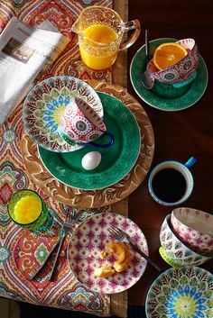 For a table that has as much personality as the people around it, layer it with statement-making pieces. Pier 1's peacock-inspired dinnerware energizes your table with rich, hand-painted designs in upbeat hues for a deliciously boho dining experience.