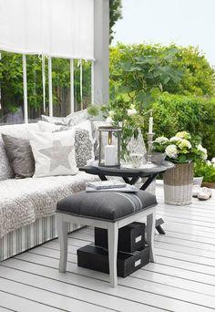 Black folding table, white dipped woven basket and white hydrangeas.