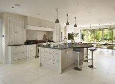 Bespoke open plan martin moore kitchen featuring a wooden breakfast bar mar Open Plan Kitchen Dining Living, Barn Kitchen, Kitchen Family Rooms, Country Kitchen, New Kitchen, Kitchen Decor, Kitchen Ideas, Kitchen Cabinet Design, Kitchen Cabinetry