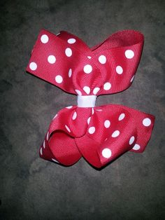 Small red with white polka dot bow