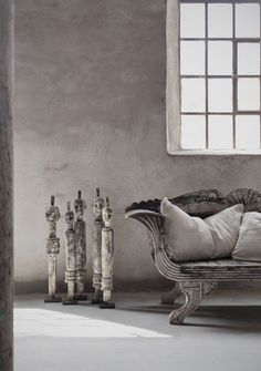 Wooden figures, wooden couch, wall & window
