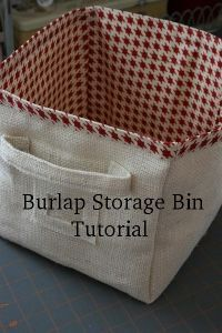 burlap storage bin tutorial - just make some to fit whatever size cubby you have  http://hopefulhomemaker.com/wp/2010/04/05/burlap-storage-bin-diy/