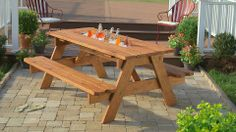Enjoying the outdoors is more fun when you have a cold beverage within reach. Maximize your patio with a DIY picnic table that has a built-in cooler. Here are the step-by-step instructions.