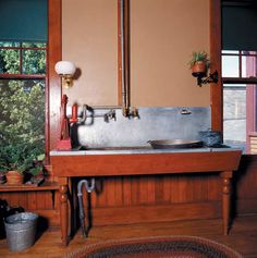 Along with the hand force pump for running water, the task-specific placement of the gaslight bracket indicates that this sink, at Billings Farm in Vermont, is in a state-of-the-art kitchen for the 1890s. (Photo: Carolyn Bates) http://www.oldhouseonline.com/a-history-of-kitchen-lighting/#